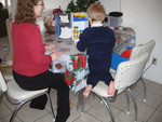 Fun with Paul's playdoh fridge on Christmas.  Heather's watching to make sure he doesn't make TOO much of a mess!