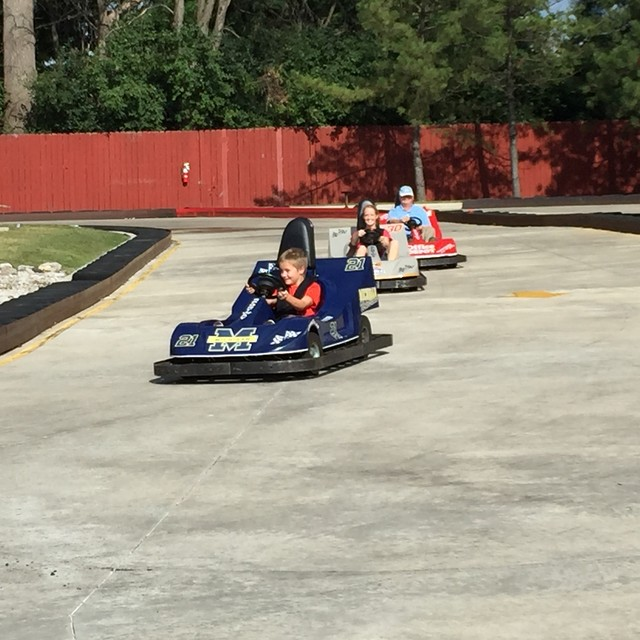 Mary, Bryan and Grandpa on go-carts.   2015-08-05
