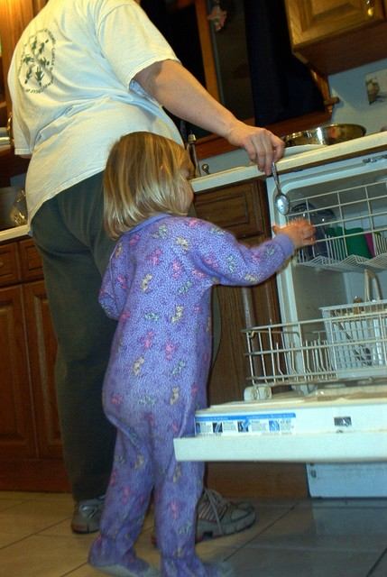 Sarah being helpful loading dishes