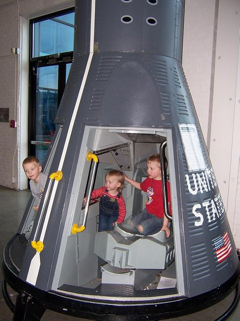All three in the space capsule